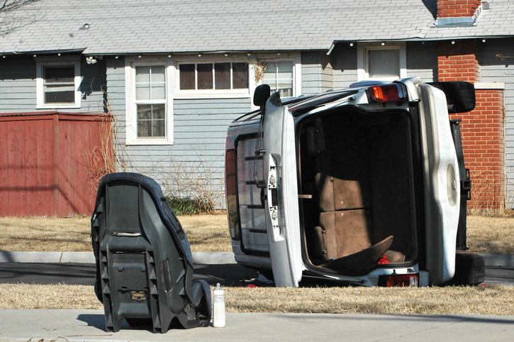 Rollover accident with carseat and baby bottle outside of vehicle.