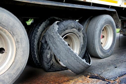 A closeup of a semi-truck tire blowout